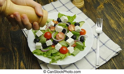seasoning vegetable salad with salt or pepper at home greek