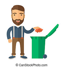 Man throwing paper in a garbage bin - A caucasian man...