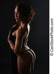 Erotica. Sensual pretty woman posing in studio