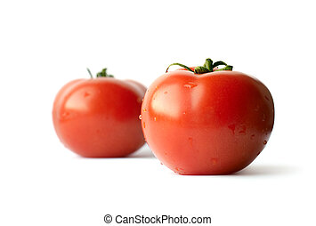 Two tomatoes isolated on white background