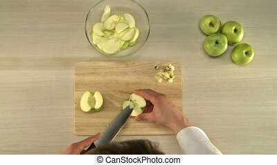 Cutting apples for baking - Cook cutting and cleaning apples...