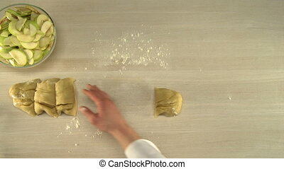 Manual dough cutting. - Cook cutting dough in four parts for...