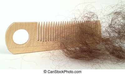 Bunch of hair on the comb. Hair loss concept