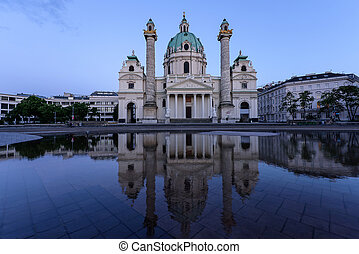 Karlskirche in Vienna Austria at sunset with reflection and...