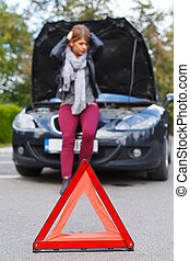Unhappy woman with broken car - Picture of a frustrated...