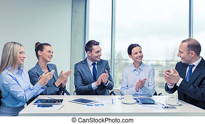 business team with laptop clapping hands - business,...