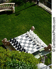 Chess game in a garden - Big chess game in a beautiful green...