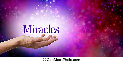 Miracles background - Female hand facing up with the word...