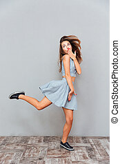 Amazed carefree young woman running