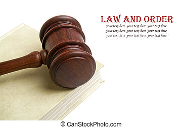 Wooden gavel and book on white background