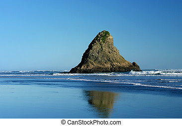 Wild West Coast Beach - A small rocky outcrop at Karekare, a...