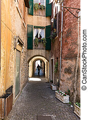 Old street and picturesque houses of Torri del Benaco. Garda...