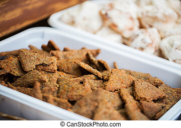 close up of cookies or cracker on serving tray