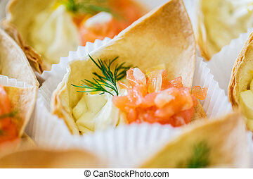close up of dough cornet with salmon fish filling - food,...