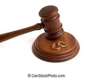 Wedding rings and wooden gavel on a white background