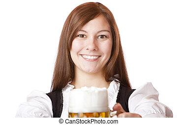 Happy smiling Bavarian woman in dirndl holding Oktoberfest beer stein