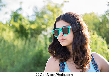Portrait of beautiful teen girl in sunglasses - Portrait of...