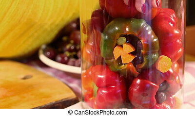 Pickle Peppers - Woman placing peppers filled with grapes...