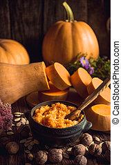 Pumpkin millet porridge with pumpkin in the background. Still life