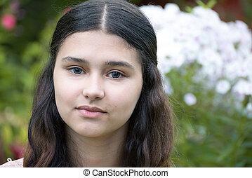 teen girl against white phlox - A teen girl against a white...