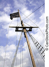 Black flag in a ship mast - Black pirate flag in a sailboat...