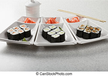 Various maki served with pickled ginger and wasabi mustard...