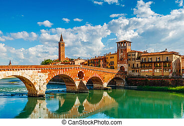 Bridge Ponte Pietra in Verona on Adige river Veneto region...