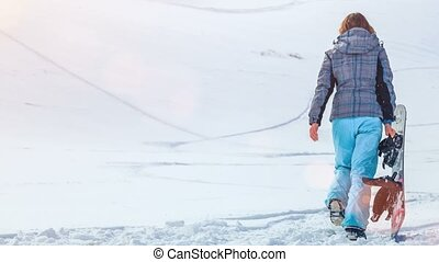 Snowboarder girl. 4k, 25fps - Young snowboarder girl in...