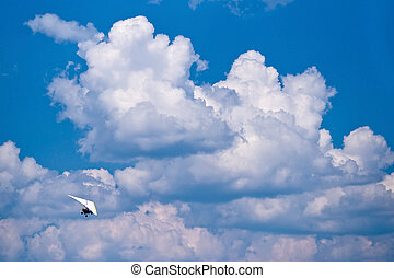 Hang-glider - The hang-glider flying in the cloudy sky