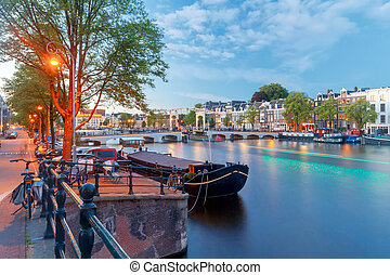 Amsterdam. Skinny Bridge at sunset. - Skinny Bridge in night...