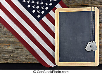 military dog tags on chalkboard