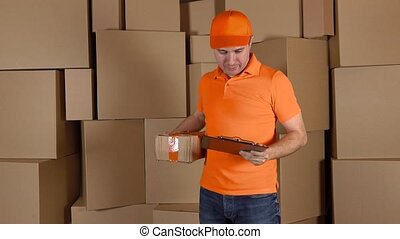 Man in orange uniform delivering heavily damaged parcel to...