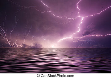 Lightning over water - Multiple lightning bolts reflected in...