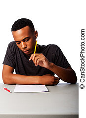 Student concentrating for test exam - Handsome student...