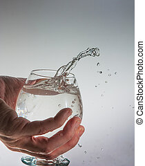 hand with a glass of water