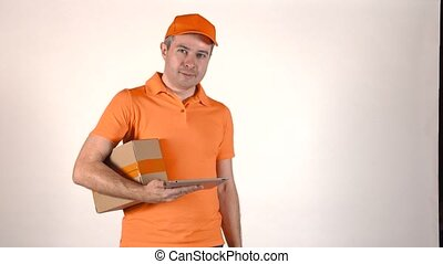 Delivery man in orange uniform using his tablet PC and...