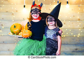 Happy children during Halloween party - Happy deamon and...