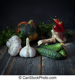 Vegetables on a surface from old boards with a dark...