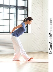 Pilates - Fitness. Woman during pilates workout