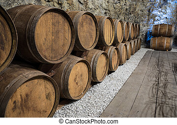 Wine Cellar with oak barrels - An old wine cellar with oak...