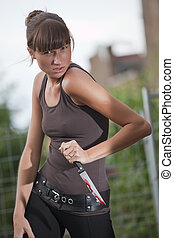 aggressive woman with bloody knife