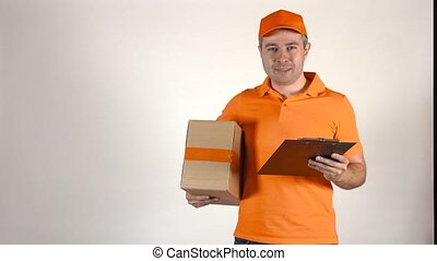 Handsome courier in orange uniform delivering a parcel. 4K...