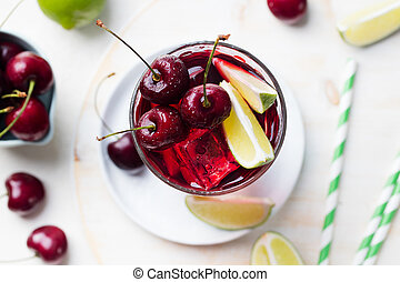 Cherry Limeade, lemonade, cola, cocktail in a tall glass Top view Copy space