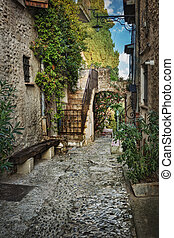 Narrow street in the old France village - Narrow street with...
