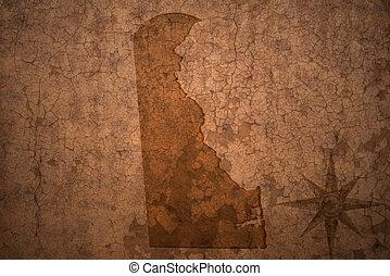 delaware state map on a old vintage crack paper background