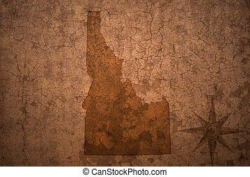 idaho state map on a old vintage crack paper background