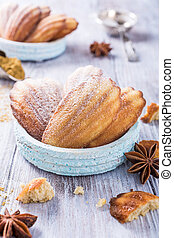 Homemade anise cookies Madeleine on old white background....