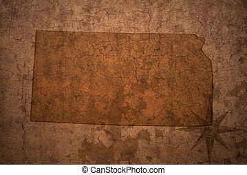 kansas state map on a old vintage crack paper background