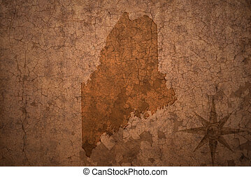 maine state map on a old vintage crack paper background