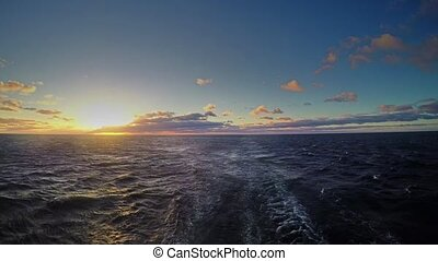 Travel by ferry in the Baltic Sea at sunrise. Time lapse